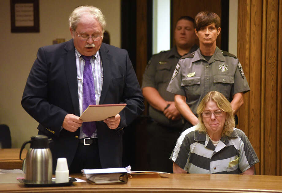Joyce Mitchell, seated at right, cries in Clinton County Court, as her lawyer Steven Johnston stands at left, Monday, Sept. 28, 2015, in Plattsburgh, N.Y. Mitchell, who helped two convicted murderers escape from a maximum-security lockup by providing them with tools, was sentenced Monday to up to seven years behind bars. (Rob Fountain/Press-Republican via AP) MANDATORY CREDIT ORG XMIT: NYPLA101 Photo: Rob Fountain / Press-Republican