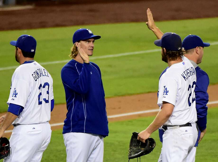 LOS ANGELES, CA - SEPTEMBER 02:  Zack Greinke #21 of the Los Angeles Dodgers celebrates a 2-1 complete game win by Clayton Kershaw #22 over the San Francisco Giants at Dodger Stadium on September 2, 2015 in Los Angeles, California.  (Photo by Harry How/Getty Images) Photo: Harry How, Getty Images
