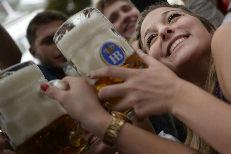 Revelers enjoy free beer at the hofbräu tent on the opening day of the 2015 Oktoberfest in Munich, Germany.More:Photos of Oktoberfest back in the day Photo: Philipp Guelland, Getty Images