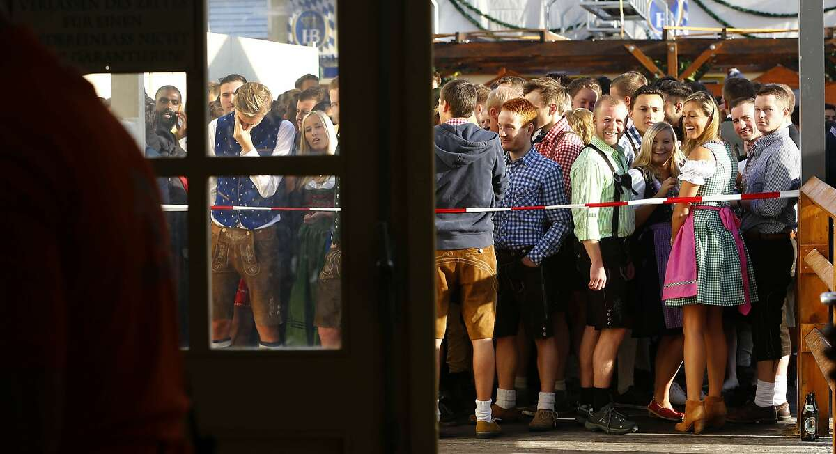 People await the opening of the 182th Oktoberfest beer festival in Munich. More: Photos of Oktoberfest back in the day