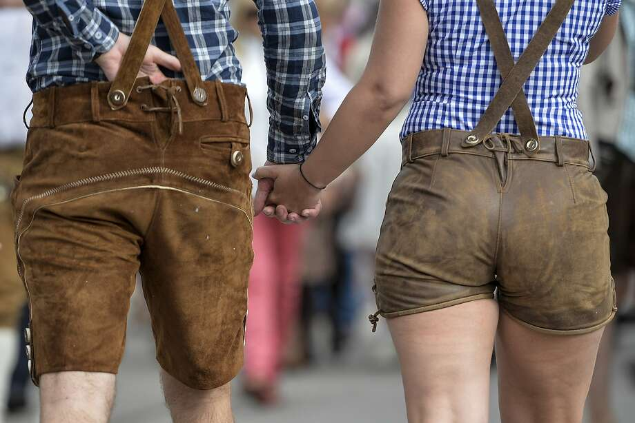 Revelersin Lederhosen hold hands on the opening day of the 2015 Oktoberfest in Munich, Germany.More:Photos of Oktoberfest back in the day Photo: Philipp Guelland, Getty Images