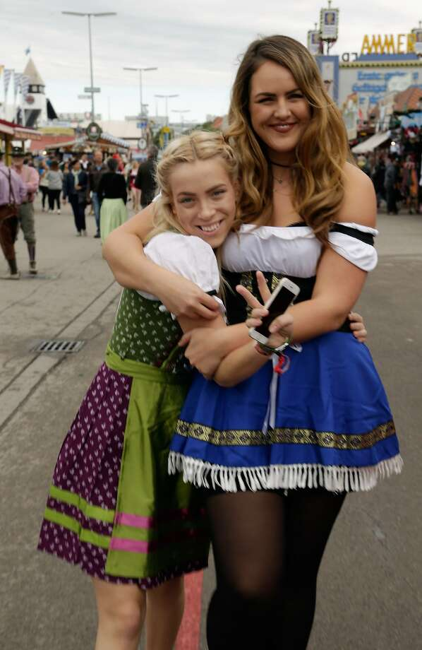 Girls dressed in mock Bavarian folk outfits arrive for the opening day of the 2015 Oktoberfest in Munich, Germany.More:Photos of Oktoberfest back in the day Photo: Johannes Simon, Getty Images