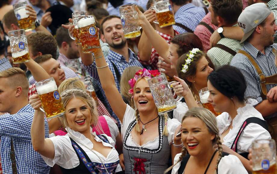 People celebrate the opening of the 182nd Oktoberfest beer festival in Munich, southern Germany.More: Photos of Oktoberfest back in the day Photo: Matthias Schrader, Associated Press