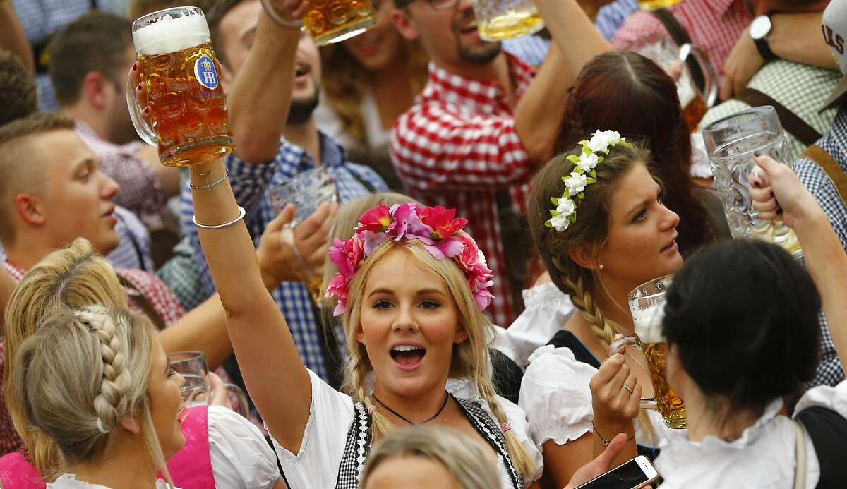 A young woman celebrates the opening of the 182nd Oktoberfest beer festival in Munich, Germany. The world's largest beer festival is held from Sept. 19 to Oct. 4, 2015. Organizers expect the festival will draw millions of visitors from across the globe in the world's largest beer fest. More: Photos of Oktoberfest back in the day