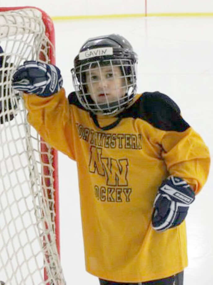 Gavin Delmonico flashes a smile near the net as he gears up for a lesson during the 2014-15 inaugural season of the Northwestern Connecticut Hockey Program's Happy Hawks program, an introduction to hockey program for children with developmental disorders. Photo: Courtesy Of Tiffany Delmonico / The News-Times Contributed