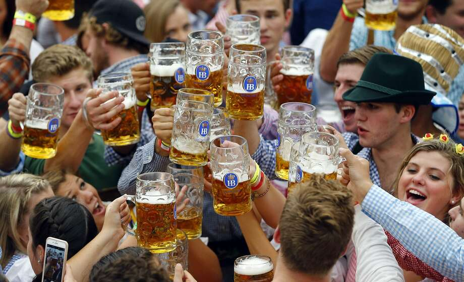 FILE-- Oktoberfest beer festival in Munich, southern Germany, Saturday, Sept. 19, 2015. If you act quick, you could be one of these happy people sipping German beer this Oktoberfest. Photo: Matthias Schrader, Associated Press