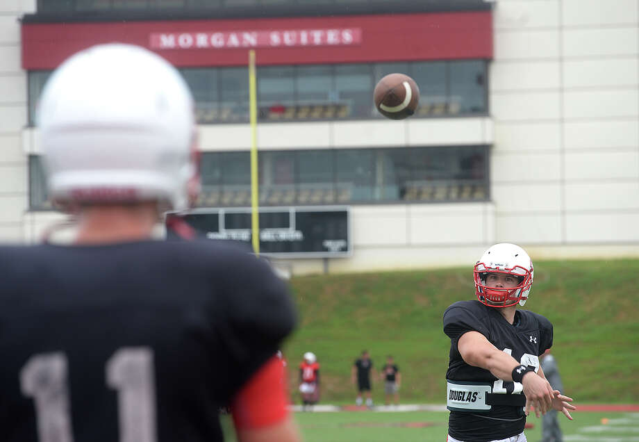 Lamar's Joe Minden gets in some practice throws as the team gets in practice Tuesday at Provost Umphrey Stadium. The Cardinals will hold their first home game Saturday.