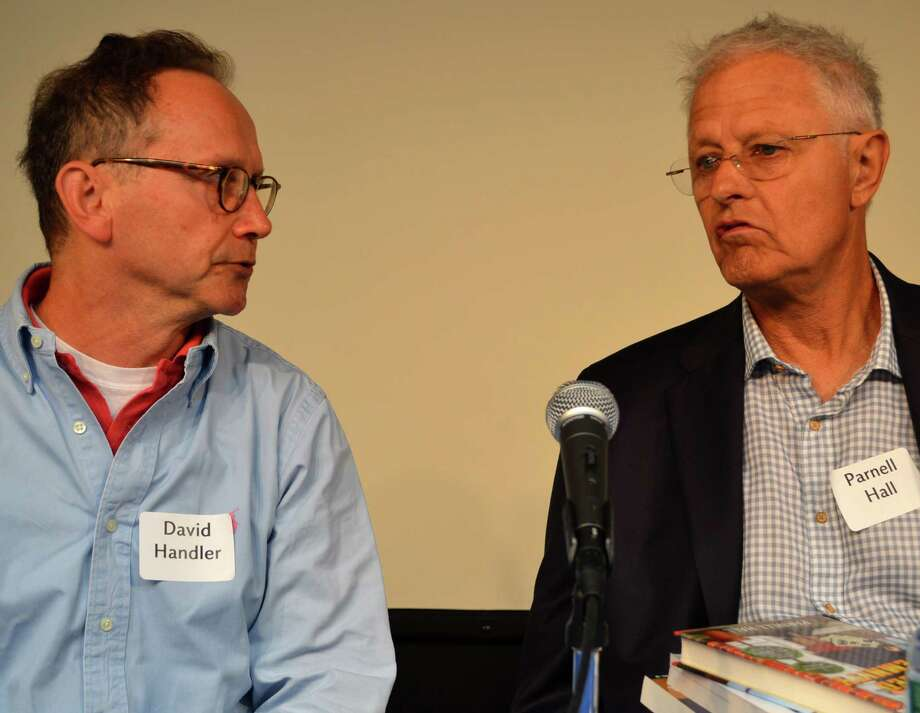Mystery authors David Handler, left, and Parnell Hall talk about their craft at the CrimeCONN event at the Westport Library on Sunday. Photo: Jarret Liotta / For Hearst Connecticut Media / Westport News