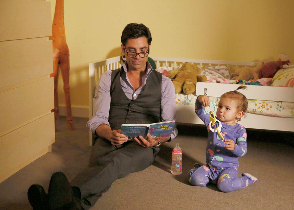 """John Stamos plays a bachelor who learns he has a son and a granddaughter in """"Grandfathered,"""" a new sitcom on Fox."""