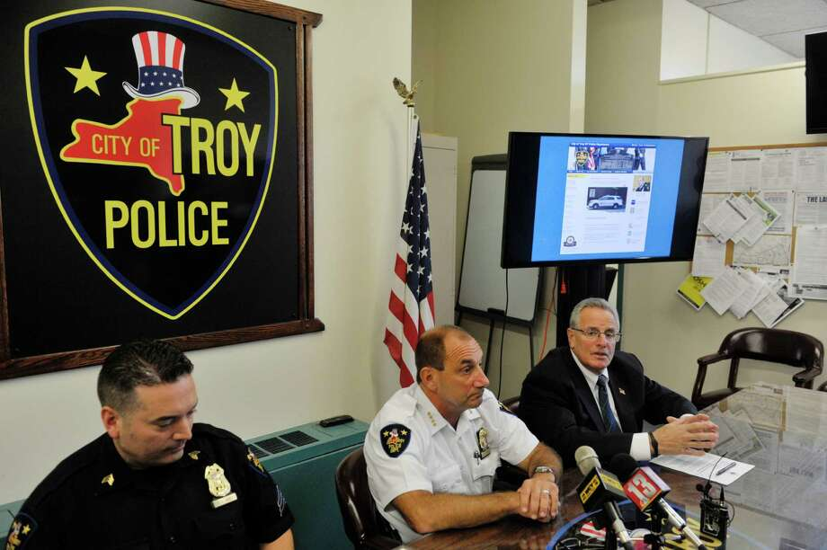 Troy Police Sergeant Stephen Seney, left, Chief of Police John Tedesco, second from left, and Troy Mayor Lou Rosamilia take part in a press conference to demonstrate the new new online reporting system, Coplogic, that the police department will be using on Monday, Sept. 28, 2015, in Troy, N.Y.  The system will be available for city residents to use to file reports for non-violent crimes.   (Paul Buckowski / Times Union) Photo: PAUL BUCKOWSKI / 00033522A