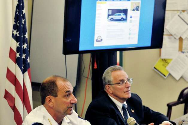 Troy Chief of Police John Tedesco, left, and Troy Mayor Lou Rosamilia take part in a press conference to demonstrate the new online reporting system, Coplogic, that the police department will be using on Monday, Sept. 28, 2015, in Troy, N.Y.  The system will be available for city residents to use to file reports for non-violent crimes.   (Paul Buckowski / Times Union) Photo: PAUL BUCKOWSKI / 00033522A