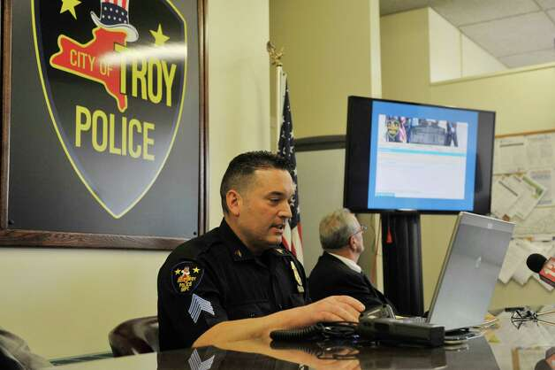 Troy Police Sergeant Stephen Seney demonstrates the new new online reporting system, Coplogic, that the police department will be using on Monday, Sept. 28, 2015, in Troy, N.Y.  The system will be available for city residents to use to file reports for non-violent crimes.   (Paul Buckowski / Times Union) Photo: PAUL BUCKOWSKI / 00033522A