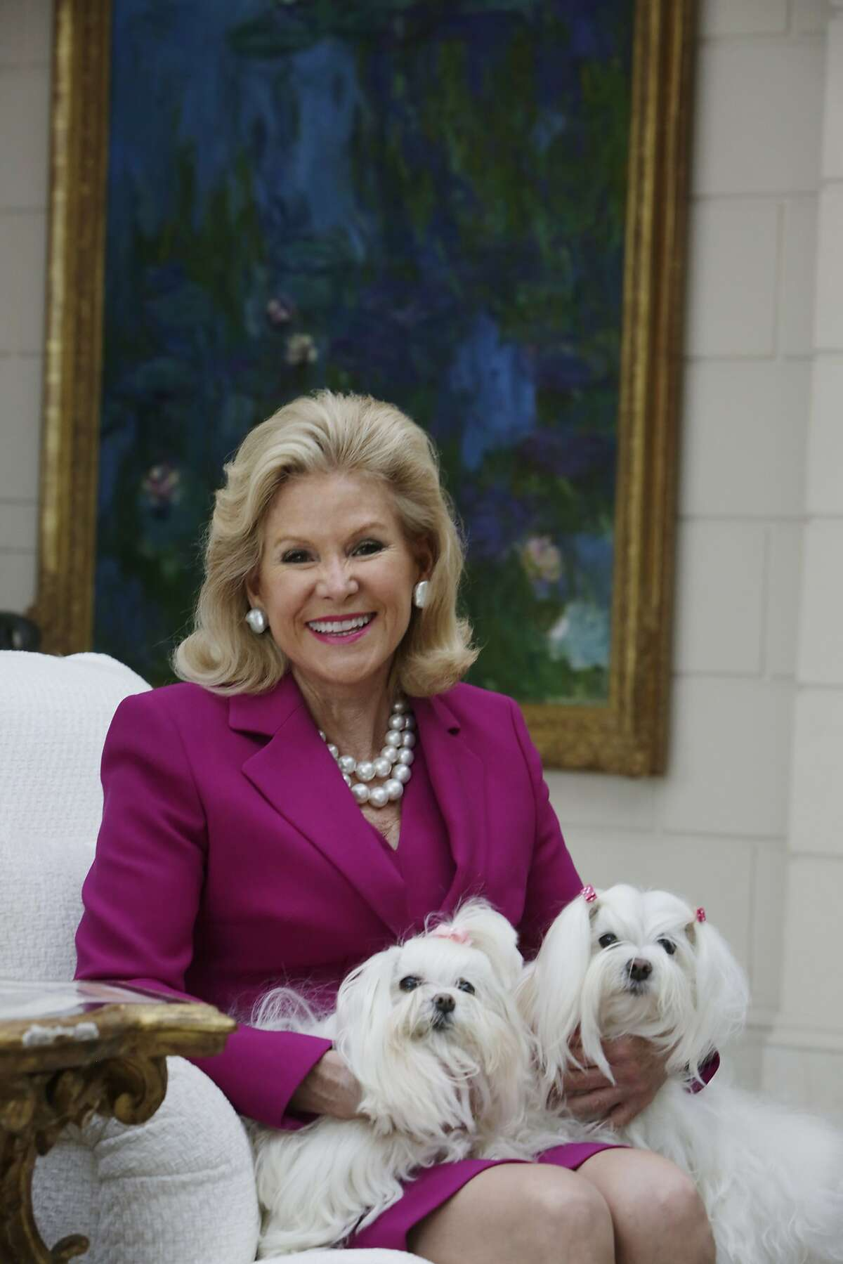 Dede Wilsey poses for a portrait at her home with her dogs Twinkle (l to r), and Dazzle on Tuesday, September 22, 2015 in San Francisco, Calif.