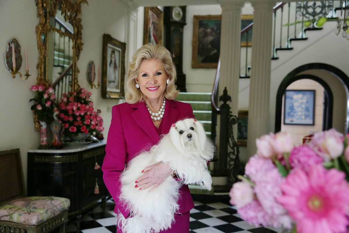 Dede Wilsey poses for a portrait with her dog Dazzle at her home on Tuesday, September 22, 2015 in San Francisco, Calif.