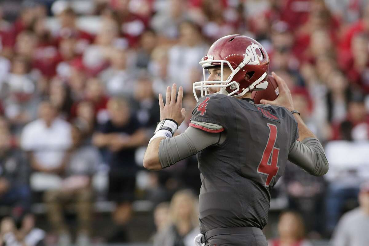 Washington State quarterback Luke Falk (4) throws against Wyoming during the first half of an NCAA college football game, Saturday, Sept. 19, 2015, in Pullman, Wash. (AP Photo/Young Kwak)