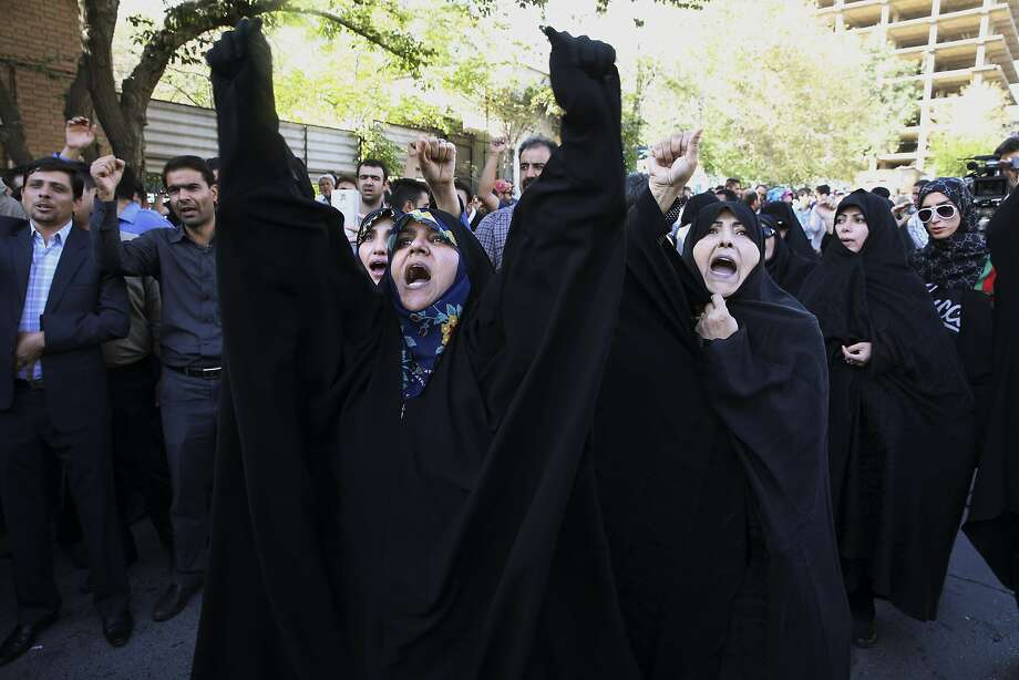 Iranians protest at the Saudi Arabian Embassy in Tehran. At least 228 Iranians died in the stampede. Photo: Vahid Salemi, Associated Press