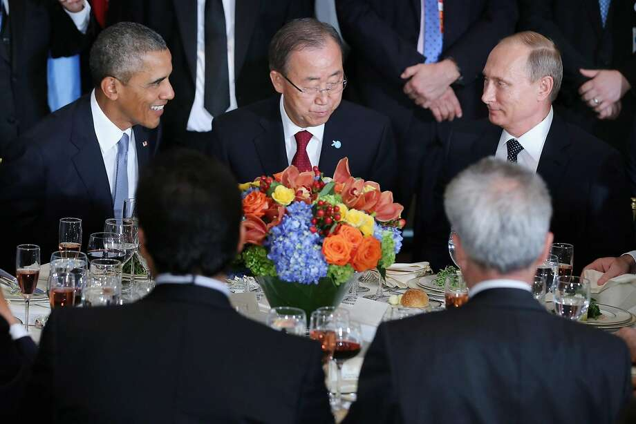 President Obama, U.N. Secretary-General Ban Ki-moon and Russian President Vladimir Putin sit together during a luncheon hosted by Ban during the 70th annual U.N. General Assembly at the U.N. headquarters in New York City. Obama held a bilateral meeting with Indian Prime Minister Narendra Modi, and was scheduled to have a face-to-face meeting with Putin later in the day. Photo: Chip Somodevilla