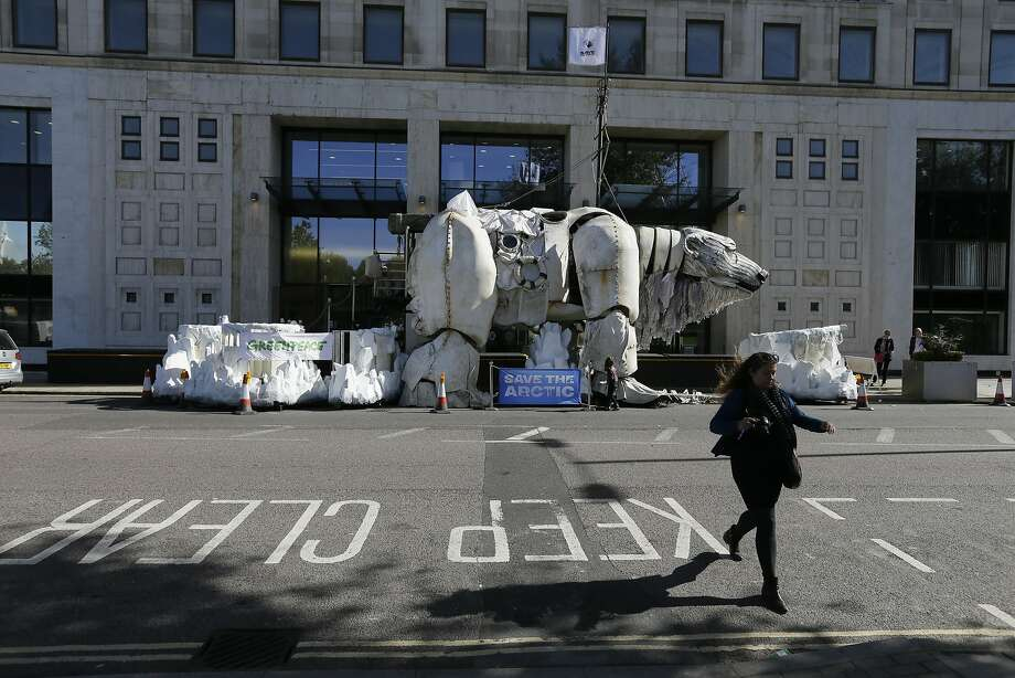 A giant polar bear model, erected by protesters from Greenpeace, stands outside the Shell Building in London on Monday. Photo: Tim Ireland, Associated Press