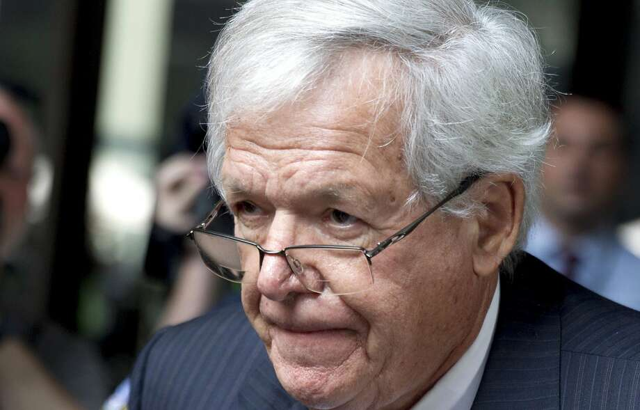 Former House Speaker Dennis Hastert departs the federal courthouse in Chicago in June after his arraignment on charges of violating banking rules and lying to the FBI after he allegedly agreed in 2010 to pay $3.5 million to someone to hide past misconduct. Prosecutors and attorneys for Hastert told a federal judge Monday that they're talking about a possible plea deal. Photo: Christian K. Lee, Associated Press