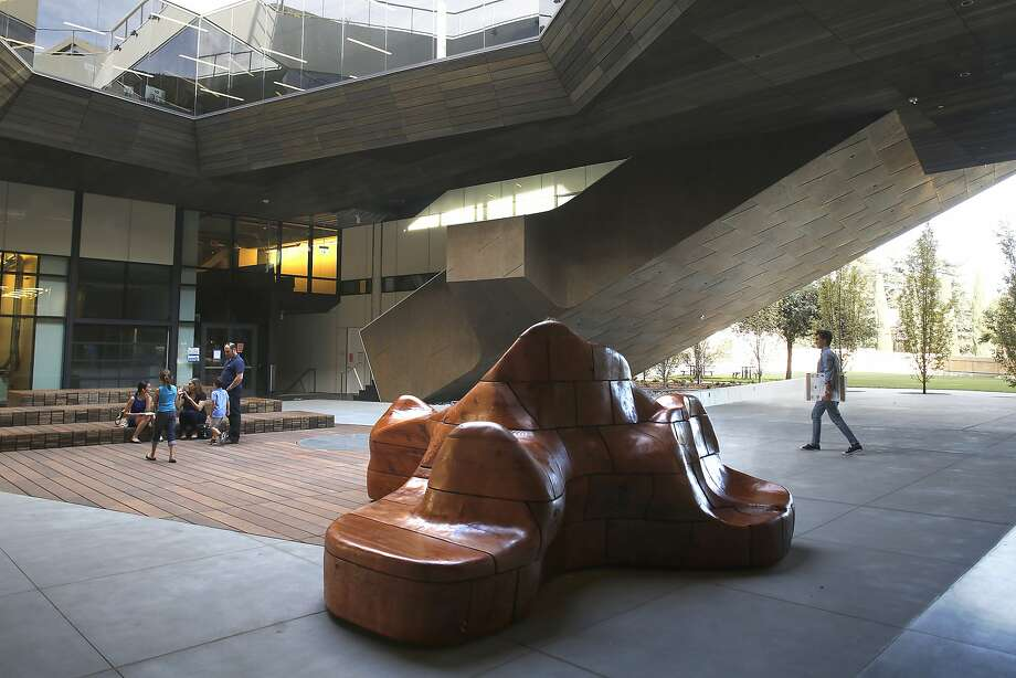 A view of the central atrium at the new McMurtry Building.  The redwood sculptural seating at right is made by Yulia Pinkusevich. Photo: Liz Hafalia, The Chronicle