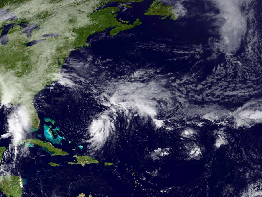 A satellite image shows Tropical Depression 11 in the Atlantic Ocean, Monday, Sept. 28, 2015.Projections show that the storm could strengthen and hit the East Coast of the United States, even threatening New York City. Take a look back at the last time a major tropical system hit the Big Apple, Super Storm Sandy.  Photo: NOAA