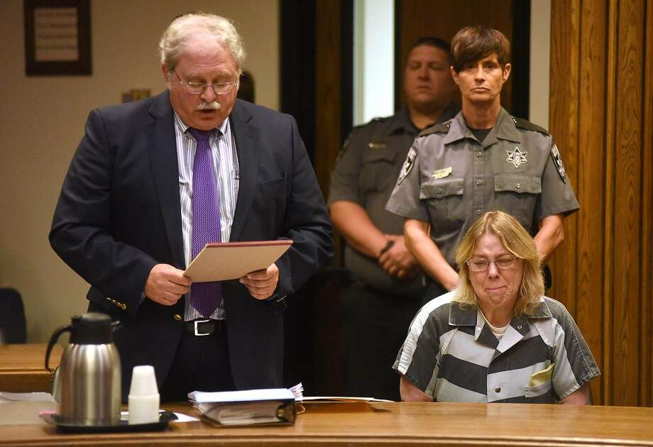 Joyce Mitchell, seated at right, cries in Clinton County Court, as her lawyer Steven Johnston stands at left, Monday, Sept. 28, 2015, in Plattsburgh, N.Y. Mitchell, who helped two convicted murderers escape from a maximum-security lockup by providing them with tools, was sentenced Monday to up to seven years behind bars. (Rob Fountain/Press-Republican via AP) MANDATORY CREDIT Photo: Rob Fountain, Associated Press