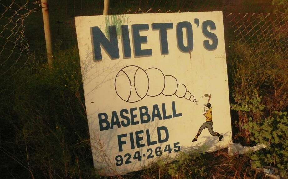 Jesus Nieto, the patriarch of a South Side family that built its own softball field in a pasture off FM 2537. The family team played at the venue, which was regulation size and included dugouts, bleachers and a concession stand. In decades past, the South Side was full of family-owned softball fields. Photo: Roy Bragg / San Antonio Express-News