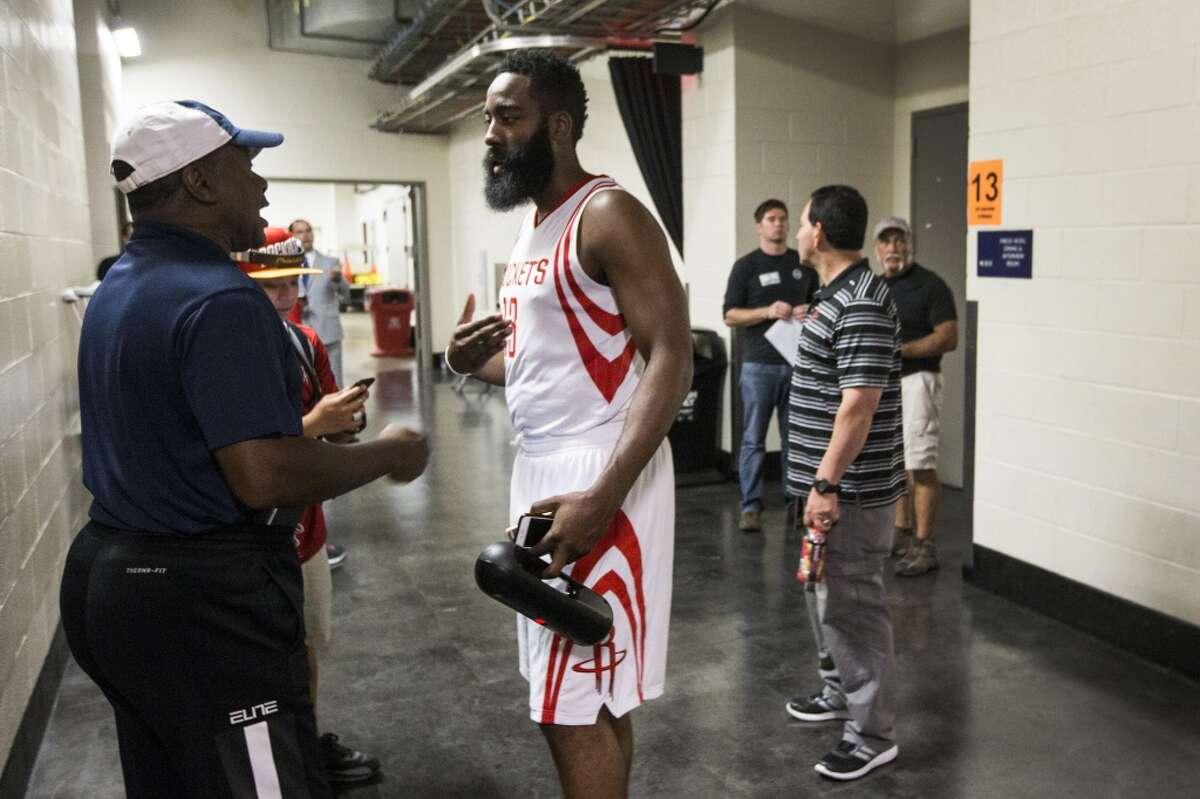Houston Rockets guard James Harden (13) talks to Rockets Hall of Famer Calvin Murphy during Rockets Media Day at Toyota Center Monday, Sept. 28, 2015, in Houston. ( Brett Coomer / Houston Chronicle )