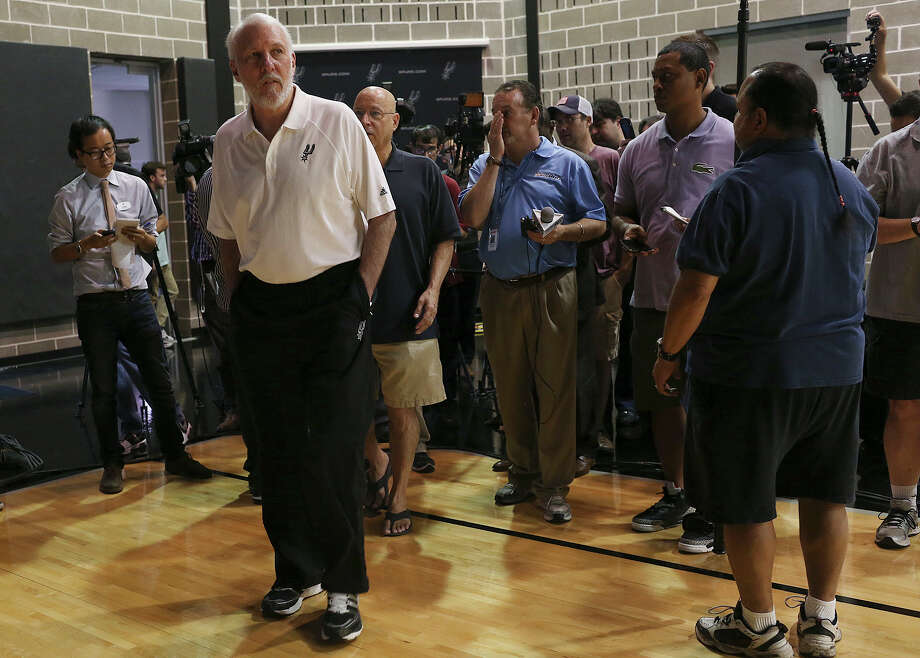 San Antonio Spurs head coach Gregg Popovich heads to another interview during Media Day at their training facilities, Monday, Sept. 28, 2015. Photo: Jerry Lara /San Antonio Express-News / © 2015 San Antonio Express-News