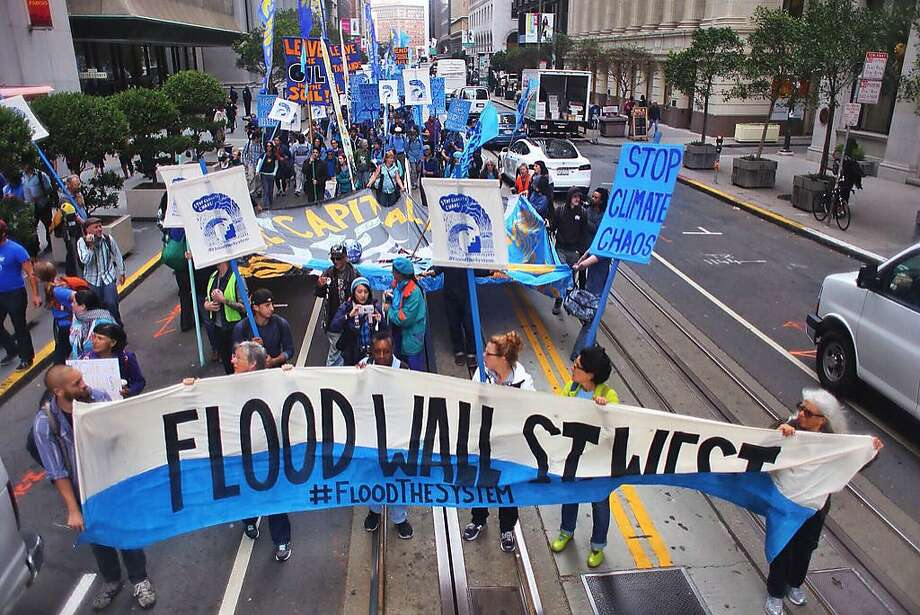 Protesters take to the streets of San Francisco's Financial District Monday to demonstrate against institutions involved in funding fossil fuel production. Photo: Rising Tide North America