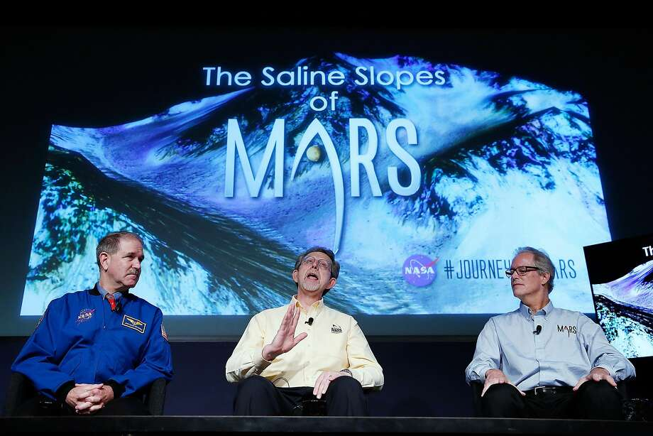 """*** BESTPIX *** WASHINGTON, DC - SEPTEMBER 28:  (L to R) John Grunsfeld, associate administrator at NASA's Science Mission Directorate, Jim Green, director of planetary science at NASA Headquarters and Michael Meyer, lead scientist for the Mars Exploration Program at NASA Headquarters, answer questions during a press conference where NASA announced new findings that provide the """"strongest evidence yet"""" of salty liquid water currently existing on Mars on September 28, 2015 in Washington, DC. """"Our quest on Mars has been to follow the water in our search for life in the universe, and now we have convincing science that validates what we've long suspected,"""" said Grunsfeld.   (Photo by Win McNamee/Getty Images) Photo: Win McNamee"""