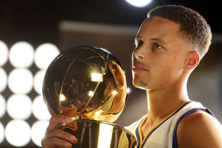 Stephen Curry does  a video shoot with the Larry O'Brien Memorial Trophy during Golden State Warriors' Media Day in Oakland, Calif., on Monday, September 28, 2015. Photo: Scott Strazzante, The Chronicle