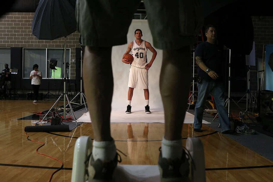 San Antonio Spurs Boban Marjanovic poses for NBAE photographer Chirs Covatta during Media Day at the training facilities, Monday, Sept. 28, 2015. On the right is Covatta's assistant, John Almarez. Photo: JERRY LARA, Staff / San Antonio Express-News / © 2015 San Antonio Express-News