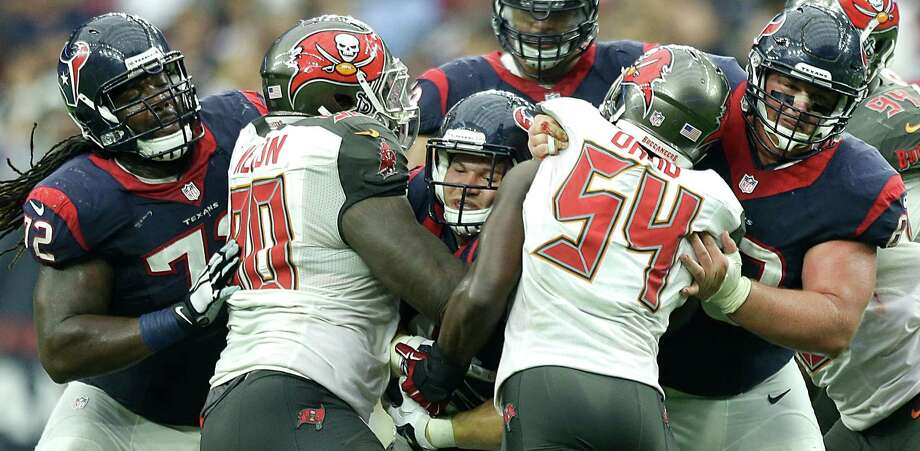 The Texans' offensive line was getting pushy with the Buccaneers on Sunday, especially in the fourth quarter. Photo: Brett Coomer, Staff / © 2015  Houston Chronicle
