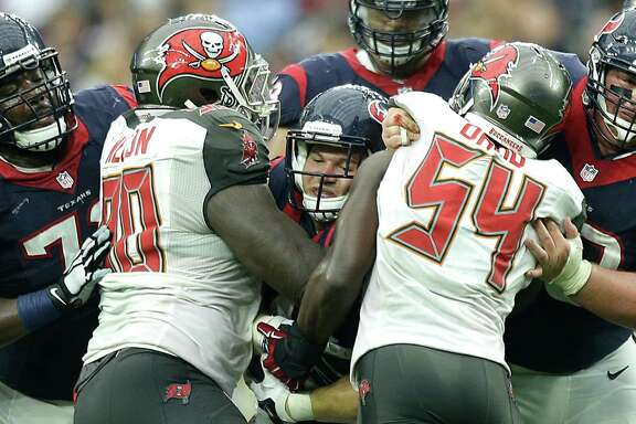 Texans fullback Jay Prosch, center, runs for a 7-yard gain and a first down against Tampa Bay  defensive tackle Henry Melton (90) and outside linebacker Lavonte David (54) during the fourth quarter at NRG Stadium.