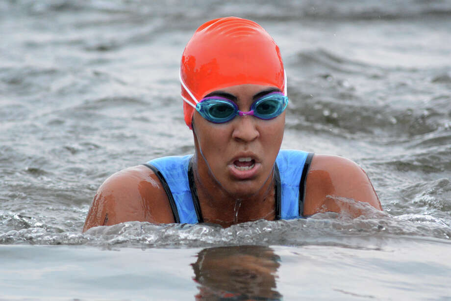 Andrea Soto-Innes, 26, finishes her 500-meter lake swim at the Katy Triathlon held in the Firethorne community on Sunday, Sept. 27, 2015. (Photo by Jerry Baker/Freelance) Photo: Jerry Baker, Jerry Baker For The Houston Chronicle
