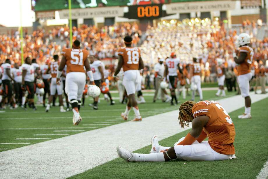 Texas wide receiver Armanti Foreman sits on the field after Oklahoma State's 30-27 win in an NCAA college football game in Austin, Texas, Saturday, Sept. 26, 2015. Photo: Jay Janner /Austin American-Statesman / Austin American-Statesman