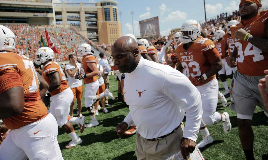 Texas head coach Charlie Strong takes the field with his team before an the game against Oklahoma State, Saturday, Sept. 26, 2015, in Austin. Photo: Eric Gay /Associated Press / AP