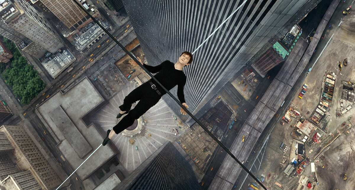Joseph Gordon-Levitt hangs out between the twin towers as French aerialist Philippe Petit in a scene from