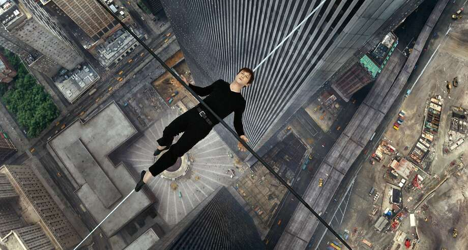 "Joseph Gordon-Levitt hangs out between the twin towers as French aerialist Philippe Petit in a scene from ""The Walk."" Photo: Courtesy Of Sony Pictures, Associated Press"