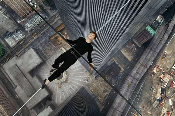 "In this image released by Sony Pictures, Joseph Gordon-Levitt portrays Philippe Petite in a scene from, ""The Walk."" The film, about high-wire artist Phillippe Petit's cabled walk between the Twin Towers in 1974, opened the 53rd New York Film Festival on Saturday, Sept. 26, 2015.  (Sony Pictures via AP)"