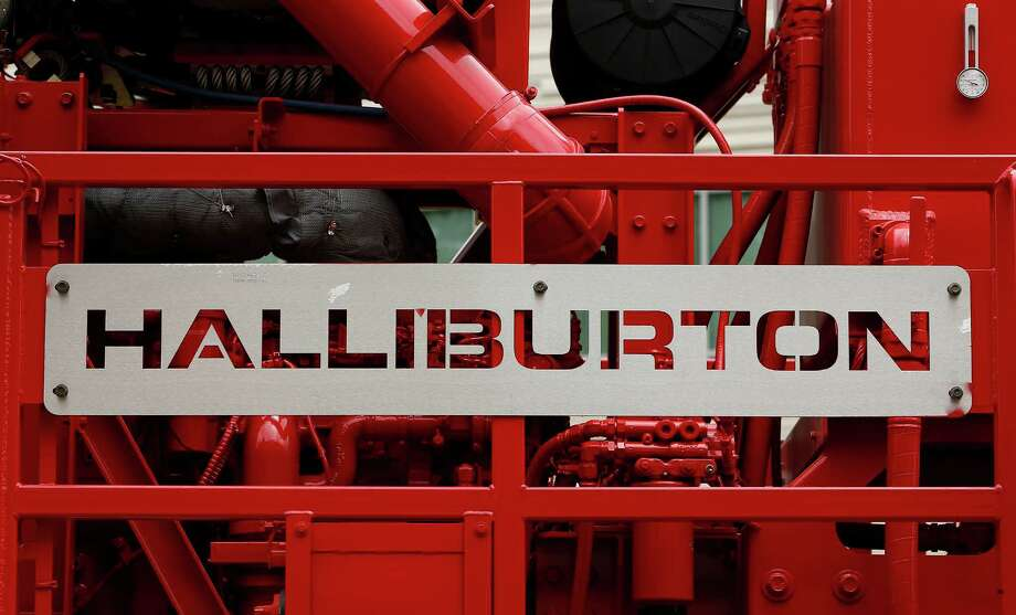 Halliburton, which displays its logo on a pressure pump outside a Houston facility, has extended its deadline for gaining regulatory approval to buy competitor Baker Hughes. (Bloomberg photo) Photo: Aaron M. Sprecher / © 2013 Bloomberg Finance LP