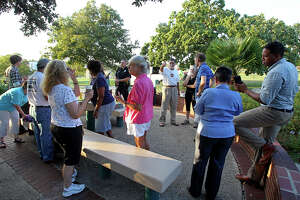 Neighbors gather in Dignowity Park  to partake in National Night Out festivities  on October 1, 2013