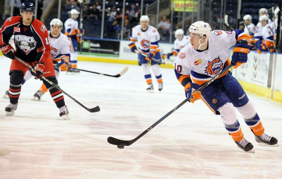 Bridgeport's Tyler Haskins controls the puck during game action against Syracuse Wednesday Mar. 24, 2010 at the Arena at Harbor Yard in Bridgeport. Photo: Autumn Driscoll / Connecticut Post