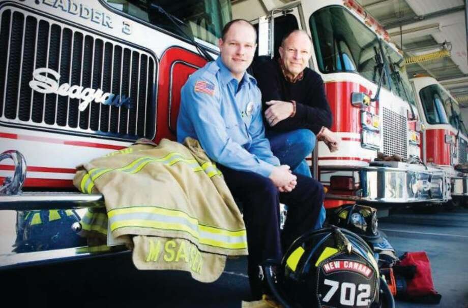 New Canaan firefighter Michael Sasser and his father Duffy Sasser, both are Stamford residents, are being honored by the Red Cross for their Feb. 21, 2009 rescue of a trapped motorist on the Merritt Parkway. The two sit in the New Canaan Firehouse on Saturday, March 20, 2010. Photo: Contributed Photo / New Canaan News