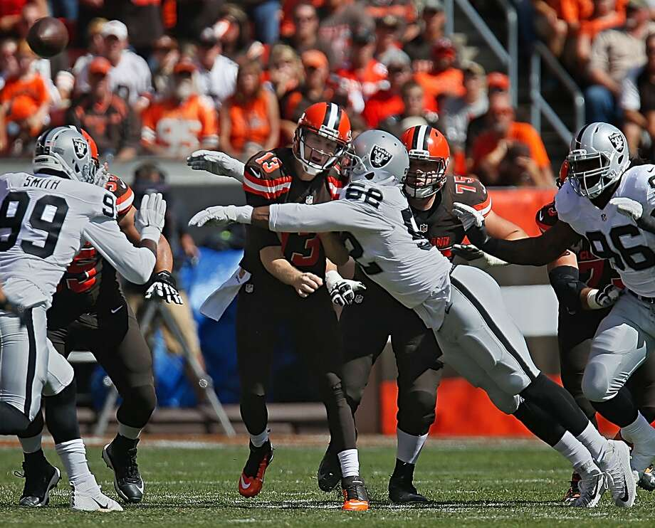 The Raiders, who had had no sacks, hounded Josh McCown, who went down behind the line of scrimmage five times. Photo: Ed Suba Jr., McClatchy-Tribune News Service
