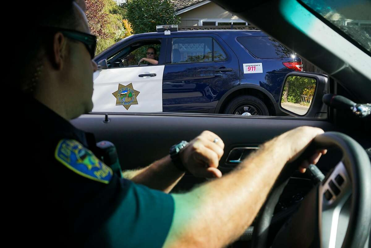 Los Altos Police Officer Katie Krauss, right, speaks to Officer Steven Spillman who patrolling their beats in Los Altos, Calif. on Monday, Sept. 28, 2015. Los Altos is statistically the safest city in the Bay Area which has seen a crime drop of 70% between 2013 and 2014.