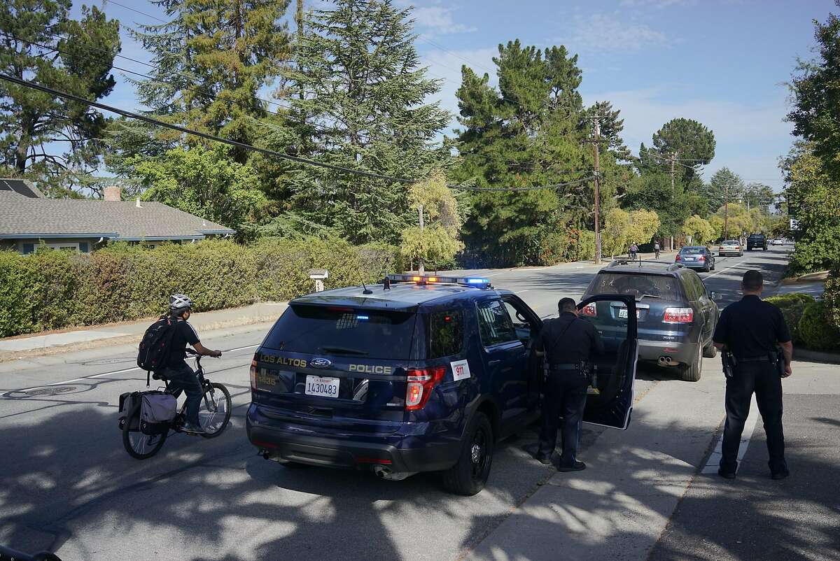 Los Altos Police Officer Steven Spillman, right, keeps an eye on traffic during a stop in Los Altos, Calif. on Monday, Sept. 28, 2015.