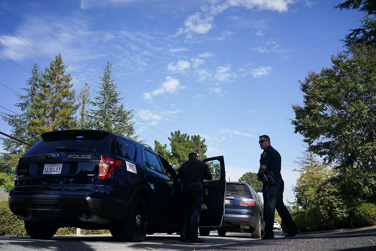 Los Altos Police Officer Steven Spillman, right, keeps an eye on traffic during a stop in Los Altos, Calif. on Monday, Sept. 28, 2015. Los Altos is statistically the safest city in the Bay Area which has seen a crime drop of 70% between 2013 and 2014.