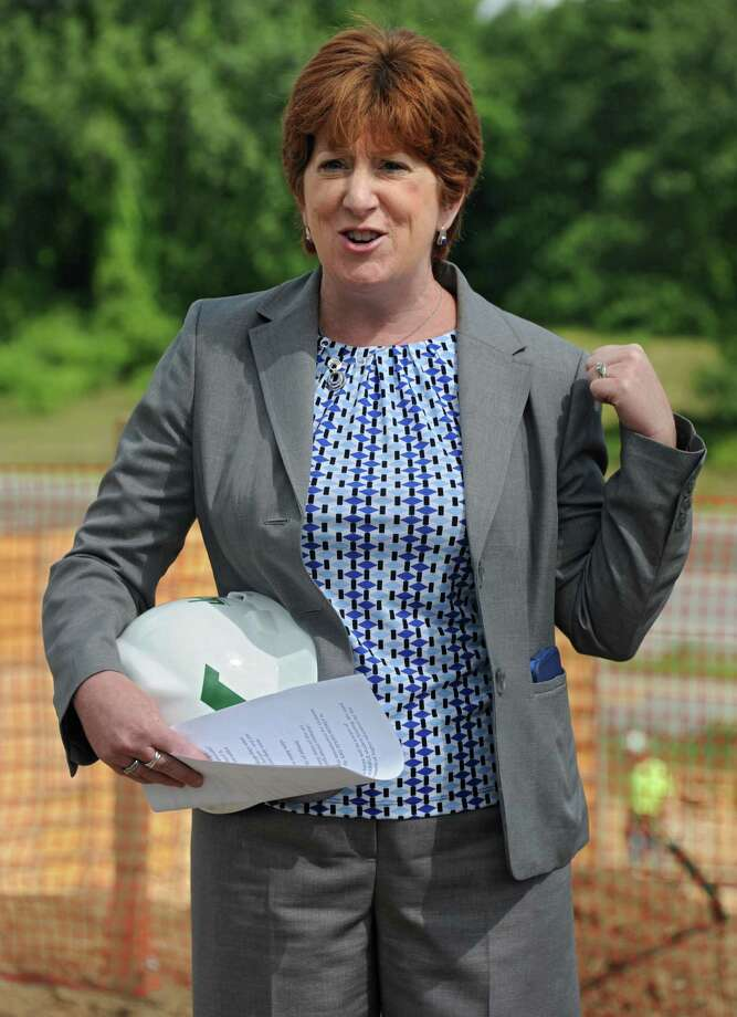 Albany Mayor Kathy Sheehan speaks during a groundbreaking for University Suites at SUNY Albany at 1475 Washington Ave. on Thursday, Aug. 13, 2015, in Albany, N.Y. Sheehan and veteran local radio man Bob Cudmore will team up to produce a weekly 30-minute interview program, Talk of the Town, that will air at noon Fridays on oldies station Magic 590 (WROW-590 AM), Sheehan?s office and the station confirmed Monday. (Lori Van Buren / Times Union archive) Photo: Lori Van Buren / Albany